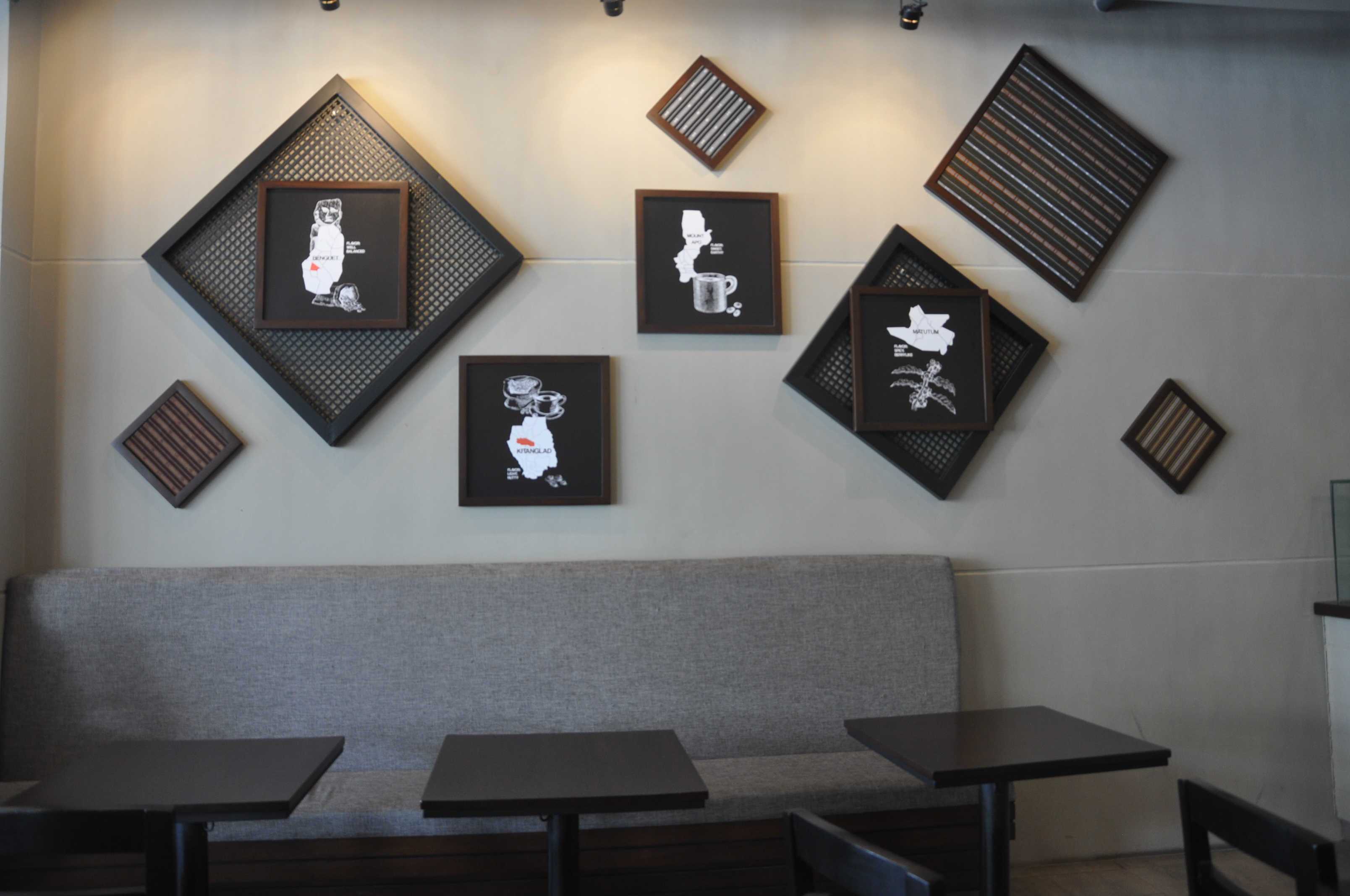 Each store of Bo's coffee features local artistry and craft. The chandeliers are designed by world-famous designer Kenneth Cobonpue while the chairs are colorfully upholstered by ANTHILL Fabric Gallery.